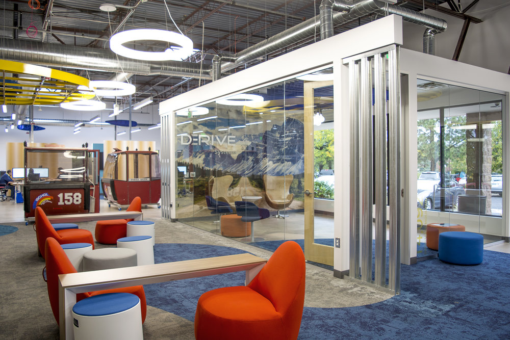 The leaders of Derive wanted a design that appealed to the most creative engineers in the Colorado area, as recruiting and retention are very important to company growth. Different styles of lounge seating, meeting rooms and small conversation pieces were provided by  Officescapes , while three red gondolas were brought in from Austria to act as small, movable huddle rooms.