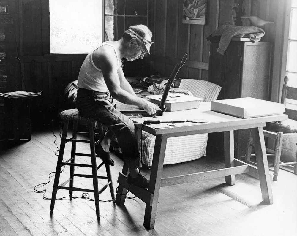 Edward trimming prints in his living room on Wildcat Hill.