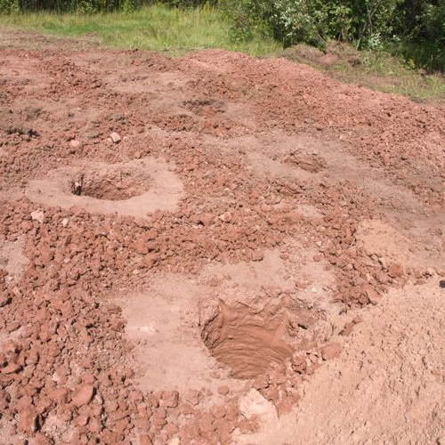 Holes were augured for a barn foundation,