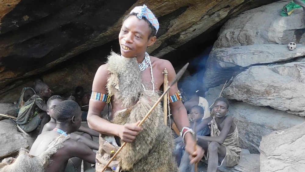 Hadzabe tribe chief explaining how they hunt