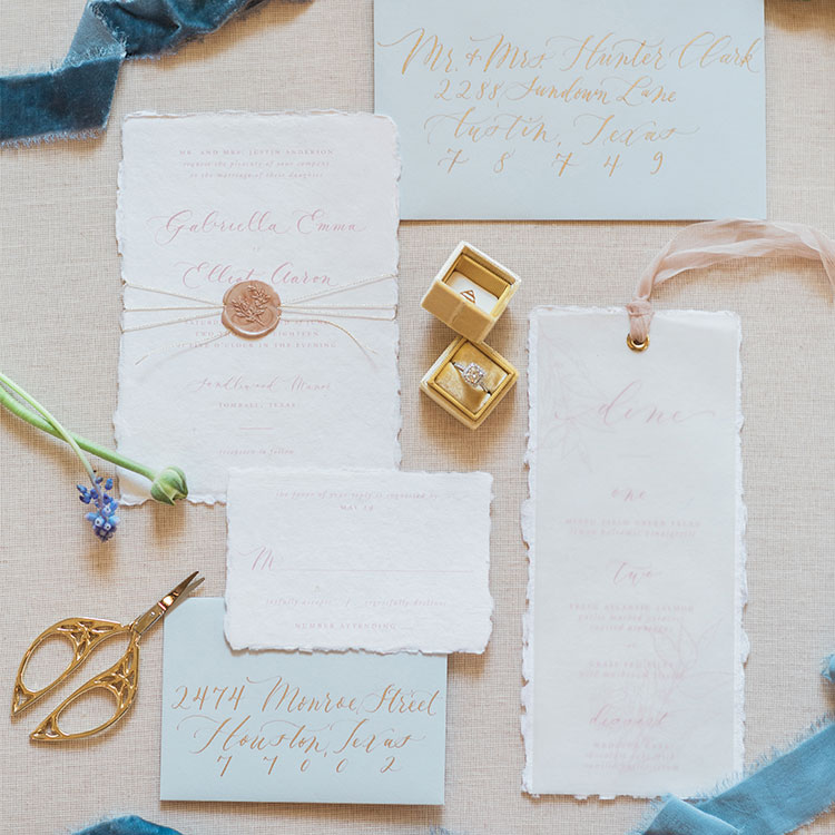 Danielle-Williams-Calligraphy-Handmade-Paper-Custom-Invitation-Suite-Wax-Seal-Light-Blue-Envelopes-Gold-Calligraphy.jpg