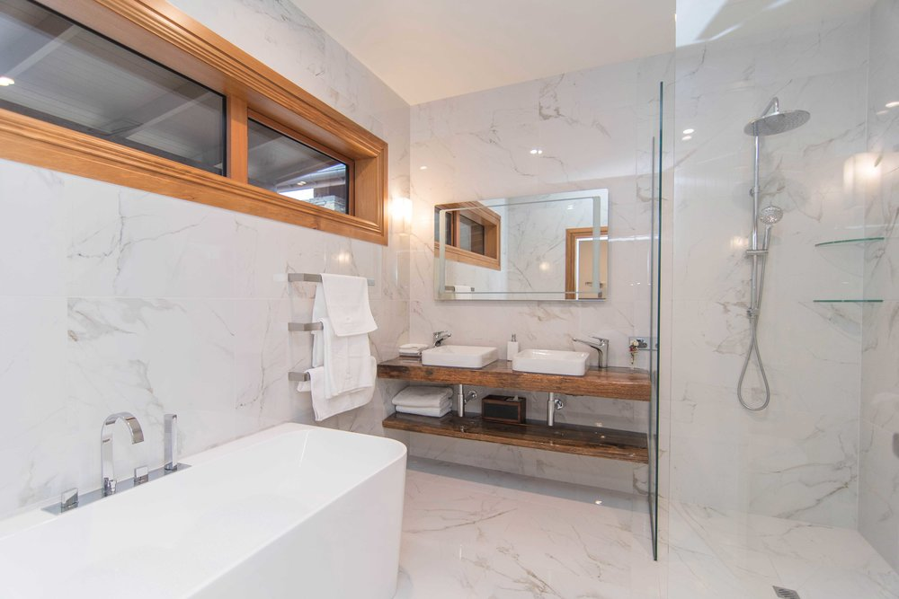 Pamper yourself in Longslip's beautifully appointed double ensuite bathroom with walk-in shower and bath.