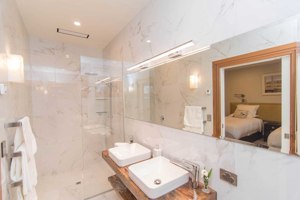Unwind in your luxurious marble-lined private ensuite with walk in shower.