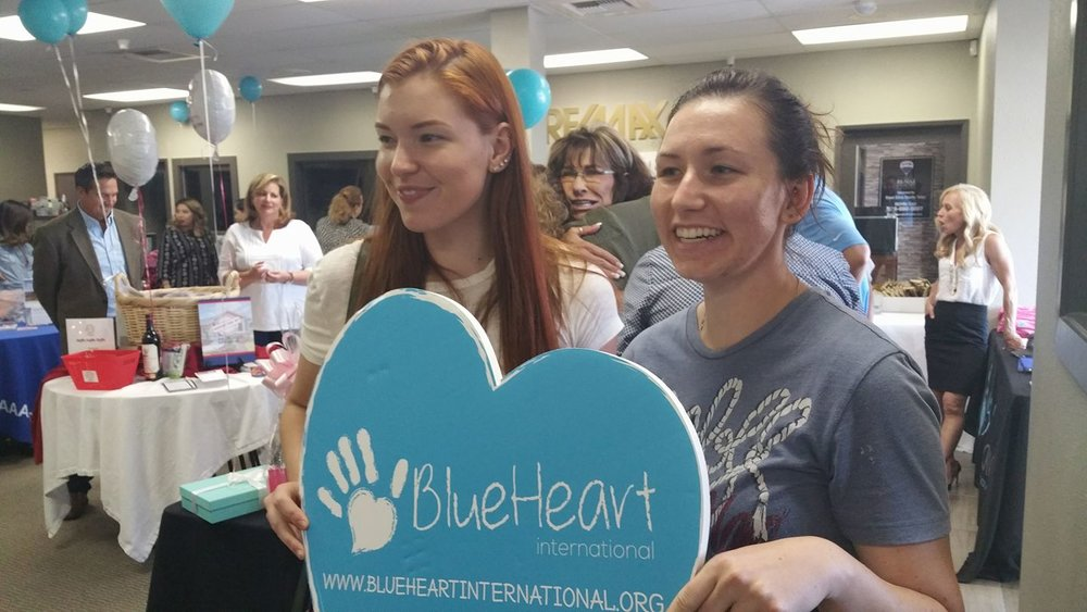 Katelyn and Karley volunteering with one of Terry's favorite nonprofits, Blue Heart International.