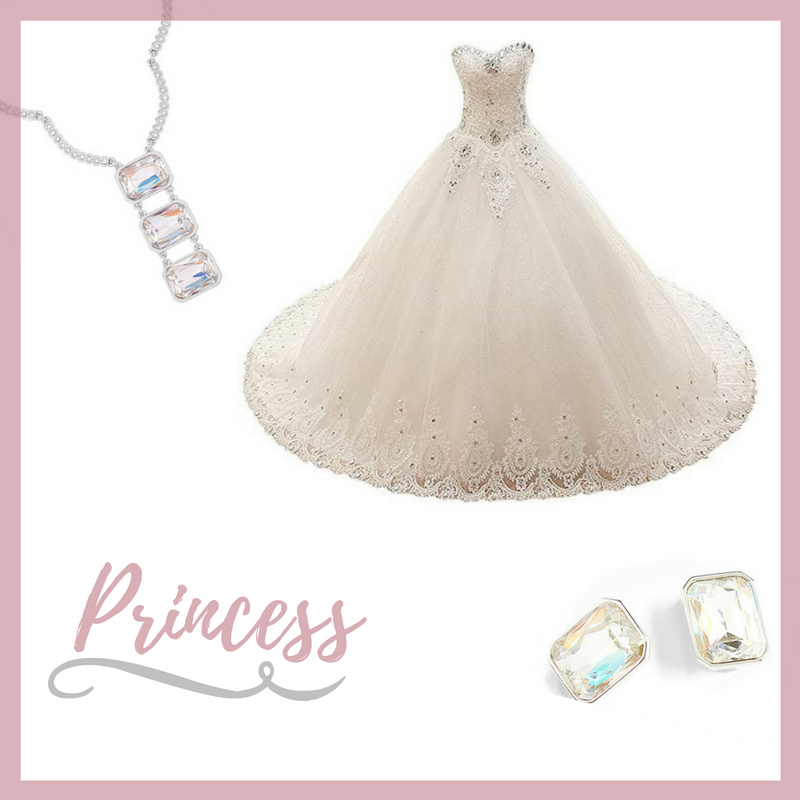 This beautiful heart line, lacy ball gown twinkles beautifully with its gems. Add our crystal clip earrings and rhodium plated, crystal encrusted and large crystal accented necklace for an extravagant look.  Sku's: 118121, 118124