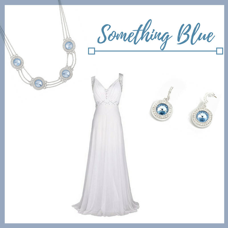 A sheath dress exhibits class and this dress is no exception! Bring your classy look together by pairing your dress with our rhodium plated, blue crystal necklace and drop earrings.  Sku's: 118091, 118092