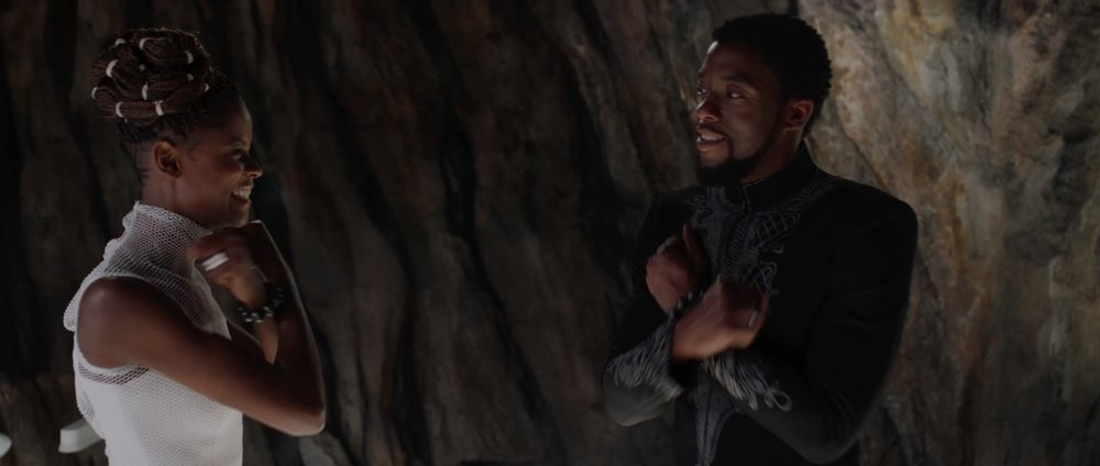 In the trailer the Wakanda salute and handshake are in reverse order of the film version. In the trailer the order feels like escalation, but in the film the scene indicates the salute is a formality, but T'Challa and Shuri have a more informal relationship.
