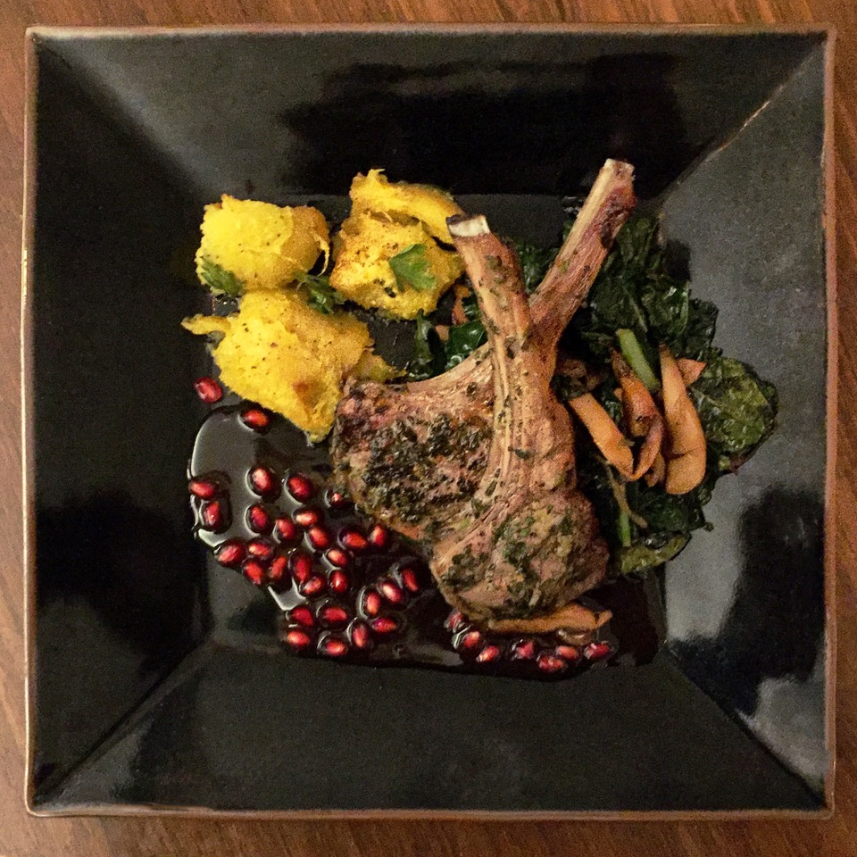 rack of lamb with pomegranate sauce, sautéed dino kale, oven-roasted winter squash                                                                                              photo courtesy of Barry Brukoff