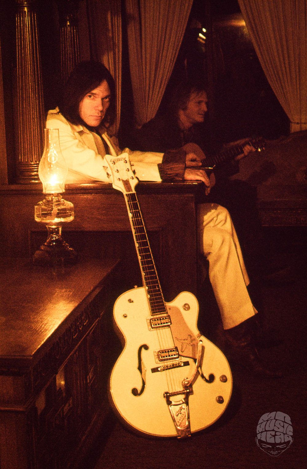 tom wilkes_neil young_guitar_couch.jpg