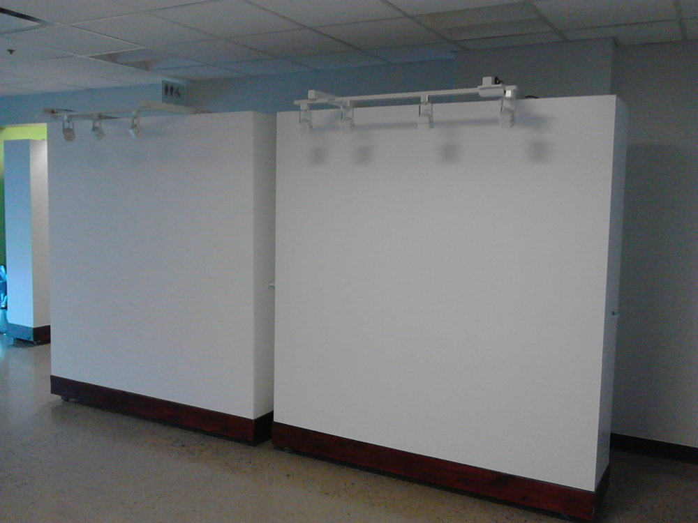 Two of four movable gallery display walls I made with a friend.
