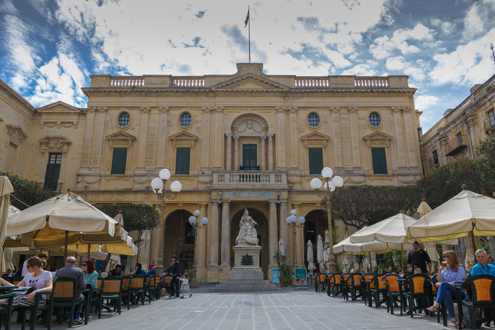 One of the many busy squares throughout Valletta. Image by Richard Coombs.