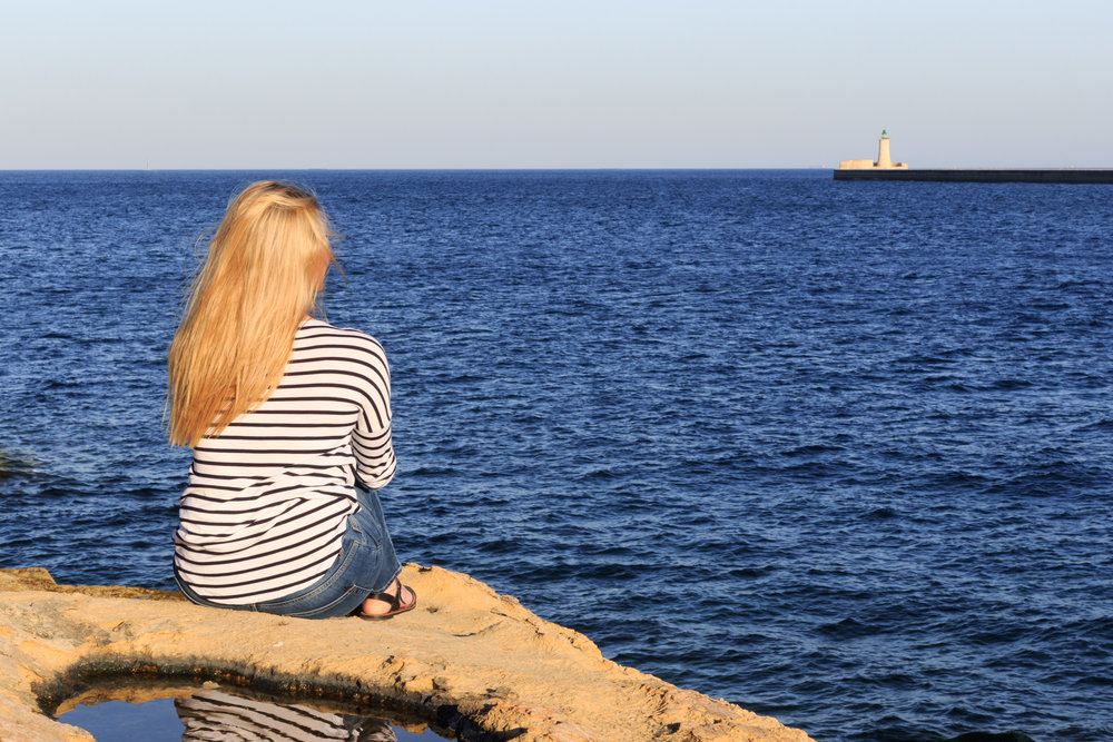 Enjoying great views of the ocean from the rock pools in Sliema Harbour. Image by Richard Coombs.