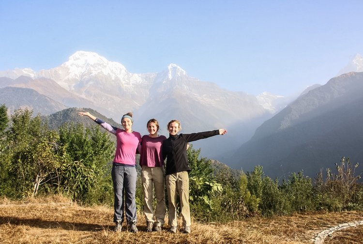 Euphoria in Ghandruk. A dry open grass field with a 270 degree view of the sun rising onto the distant Himalayas.