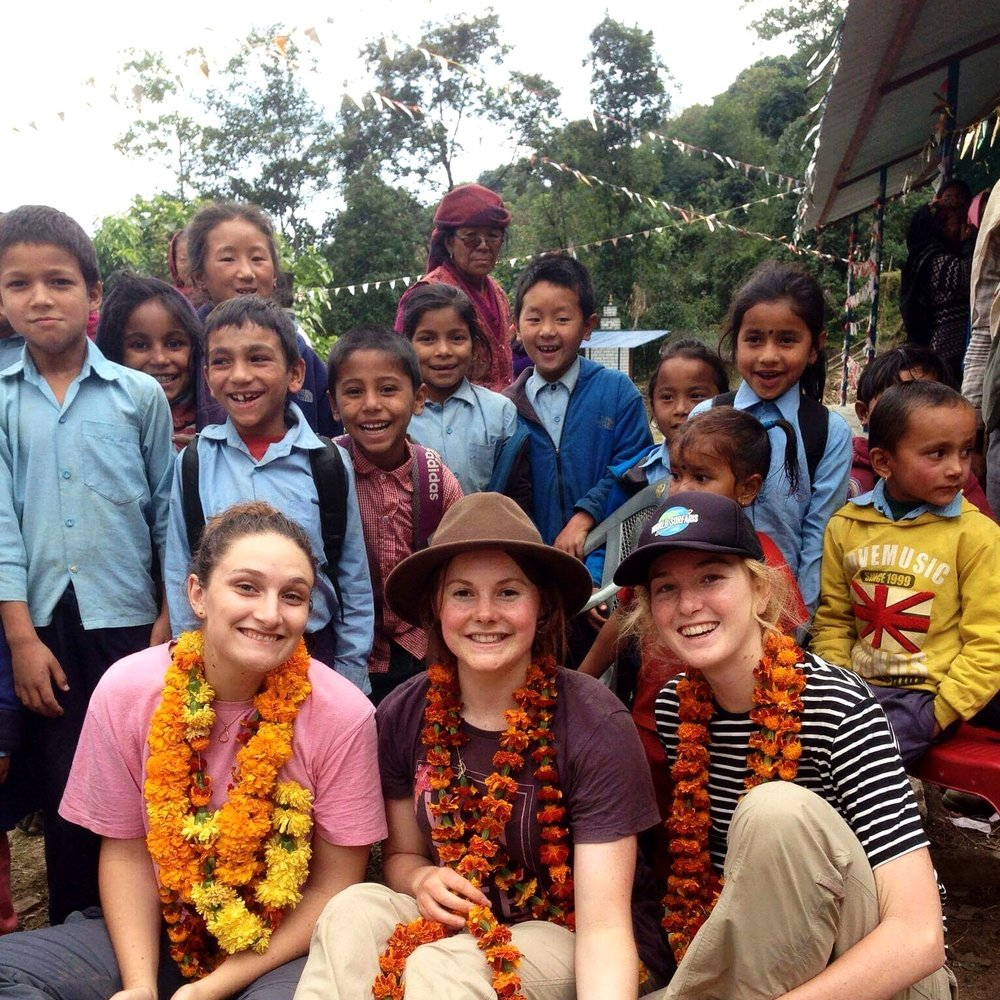 Welcomed with marigold garlands and an abundance of smiling faces, upon arrival in Dhampus after a full day of trekking through the mountains.