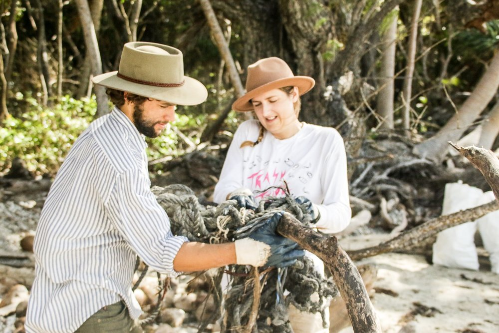 Dan and Nat unravelling fishing ropes from a piece of driftwood. @_danielgsmith @nat.woods_ @cleancoastcollective | Photo by Jemma Scott @thesalty.dreamers | Cape York, Australia