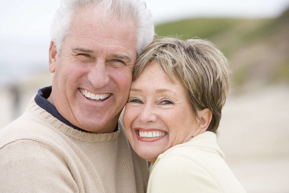 Older couple with dental implants from Drayton Dental