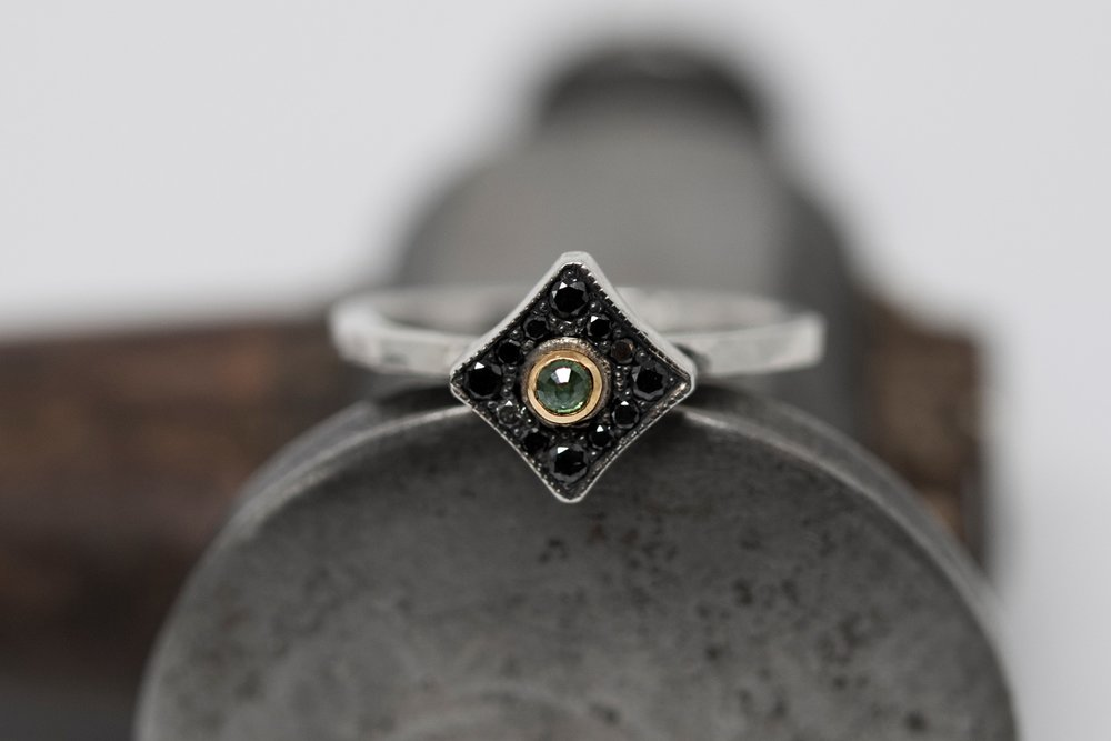 Blue and black diamond ring