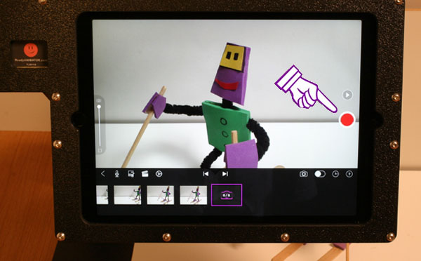 Tap the red button to capture a frame of animation on the iPad.