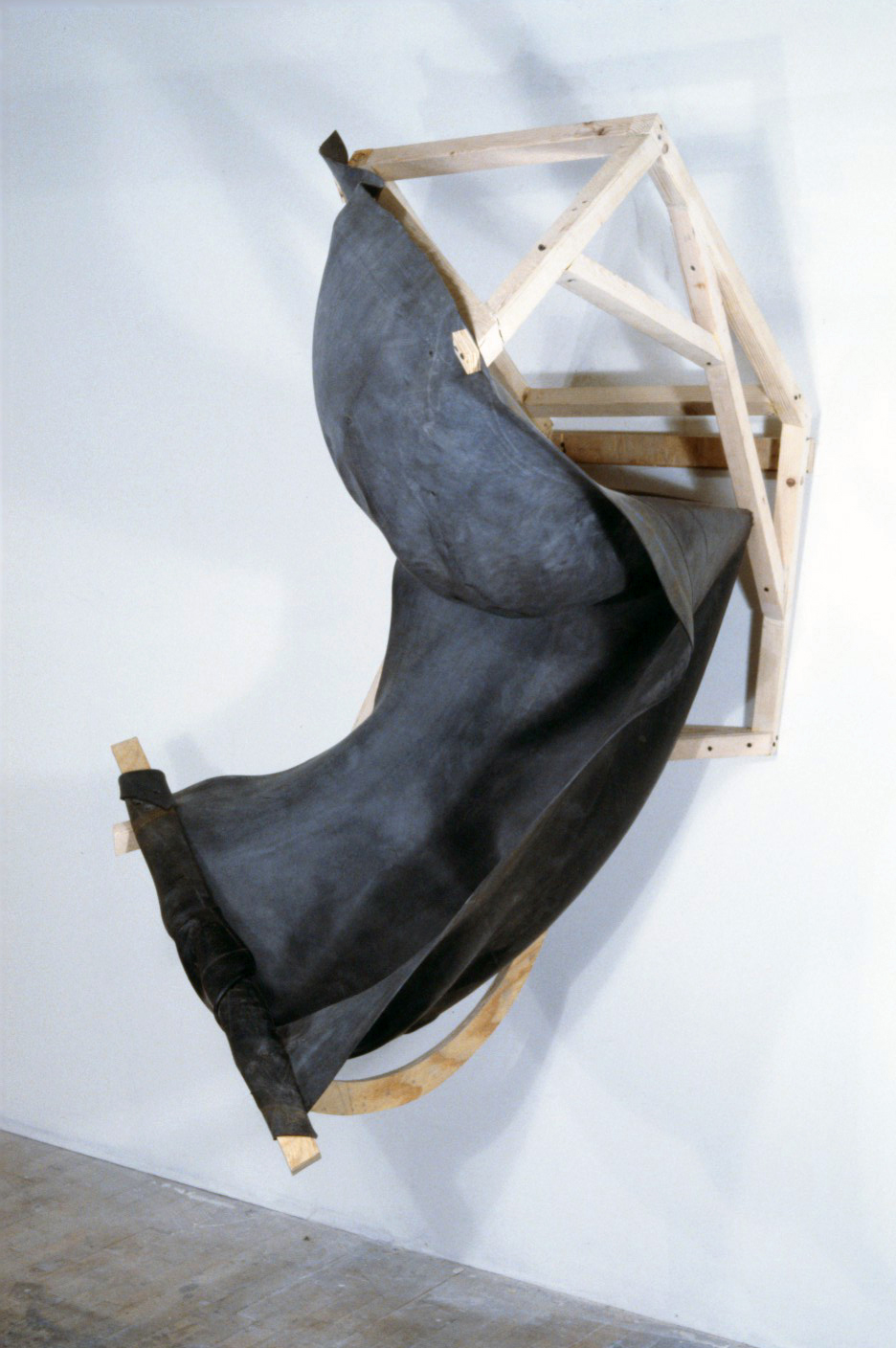 Chute   1988  rubber and wood  59 X 37 X 45""