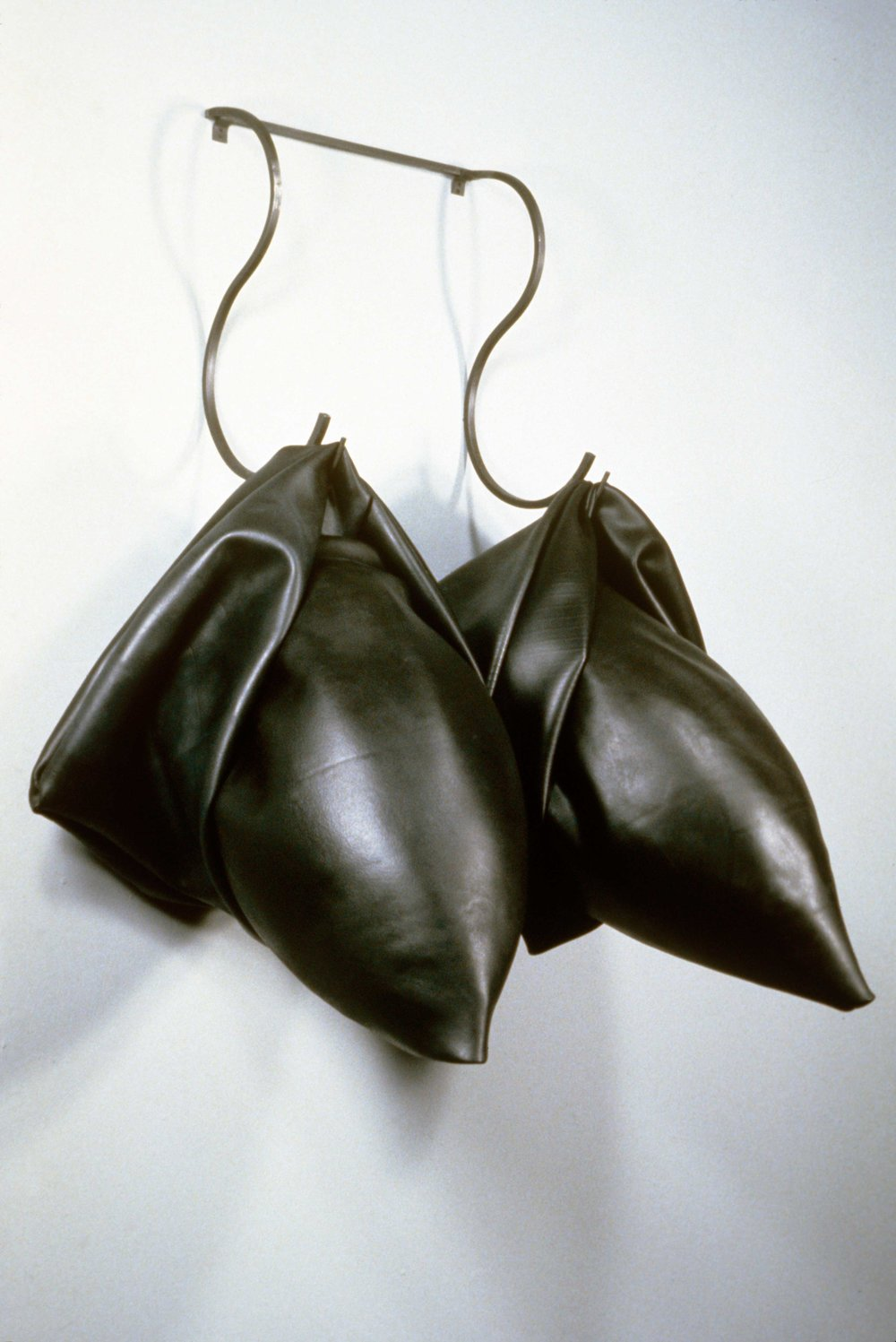 Twin Missiles   1990  rubber and steel  49 X 32 X 23""