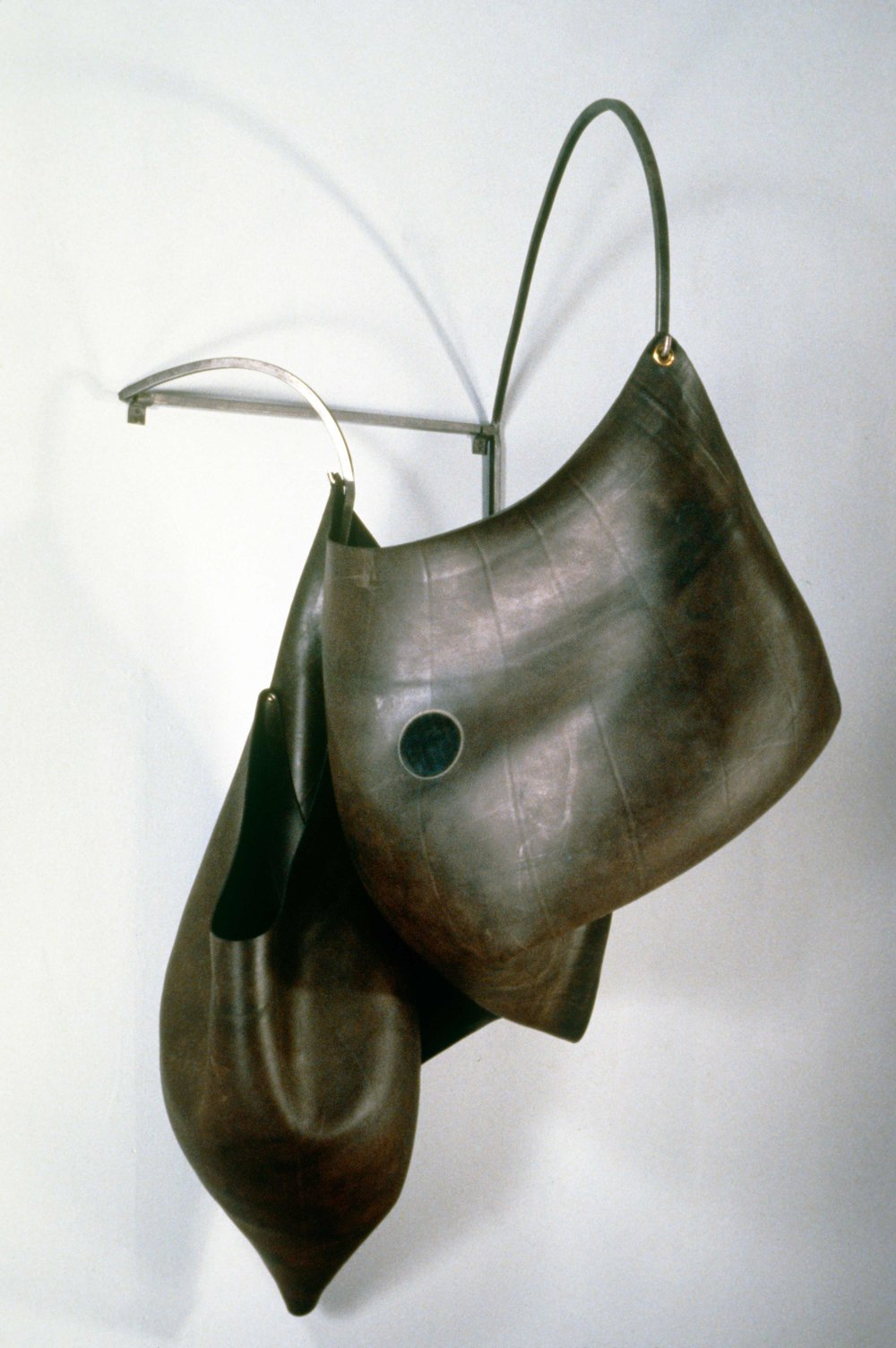 Untitled 90.2   1990  rubber and steel  60 X 32 X 34""