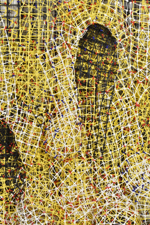 "Yellow_Black_White Drip    close-up   plastic+metal fencing  70"" x 55"" x 22""  2017"