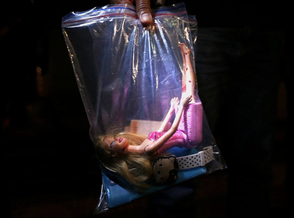 "A blood-stained plastic doll, a wristwatch, and a wallet were found on Erika Angel Reyes, 17, who was killed along with her partner, Jericho Camitan by still-unidentified riding-in-tandem gunmen on Gumamela Street, Barangay Commonwealth, Quezon City on October 27, 2016. A cardboard was left beside the victims' body, with words, ""tulak ka, hayop ka"" (You are a pusher, you are an animal)."