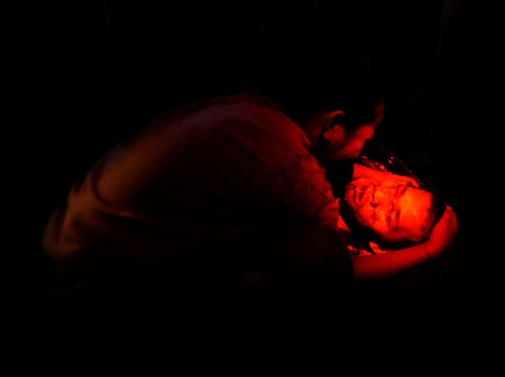 Daughter of victim Edmar Velarde, 31, grieves at the corpse of her father who was killed along with four others by still-unidentified suspects at Barangay Addition Hills, Manduluyong City on the eve of All Saint's Day.