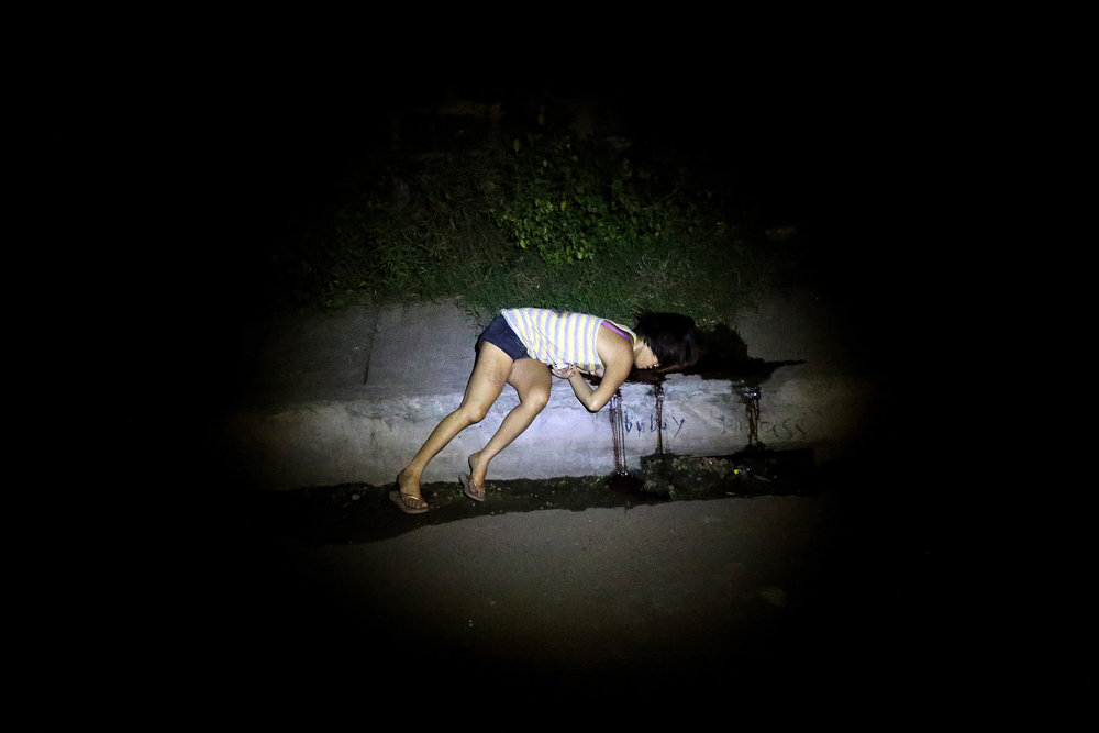 A still unidentified woman is found dead under the C3 Bridge, Barangay Northbay Boulevard South, Navotas City on November 29, 2016. Two sachets of shabu or methamphetamine were found with the victim.