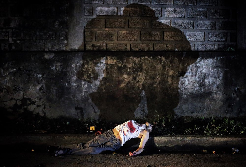 "The body of alleged drug pusher Jesus Jonas alias ""Hudas"" lies dead on West Riverside Street, Quezon City after being killed in a buy-bust operation on October 8, 2016."
