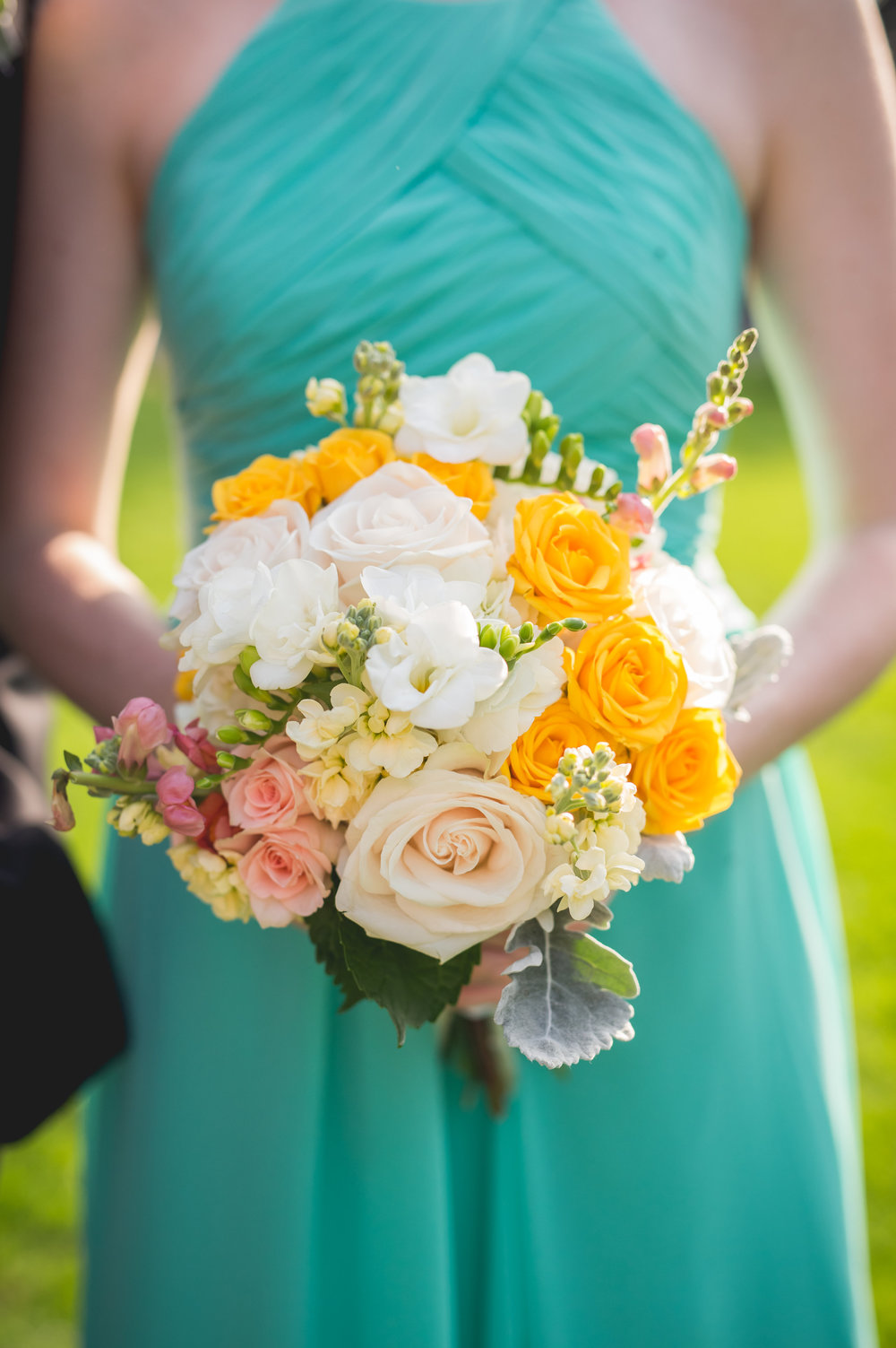 A colorful, cheery, and happy wedding!  Photo by Heartfelt Studios.