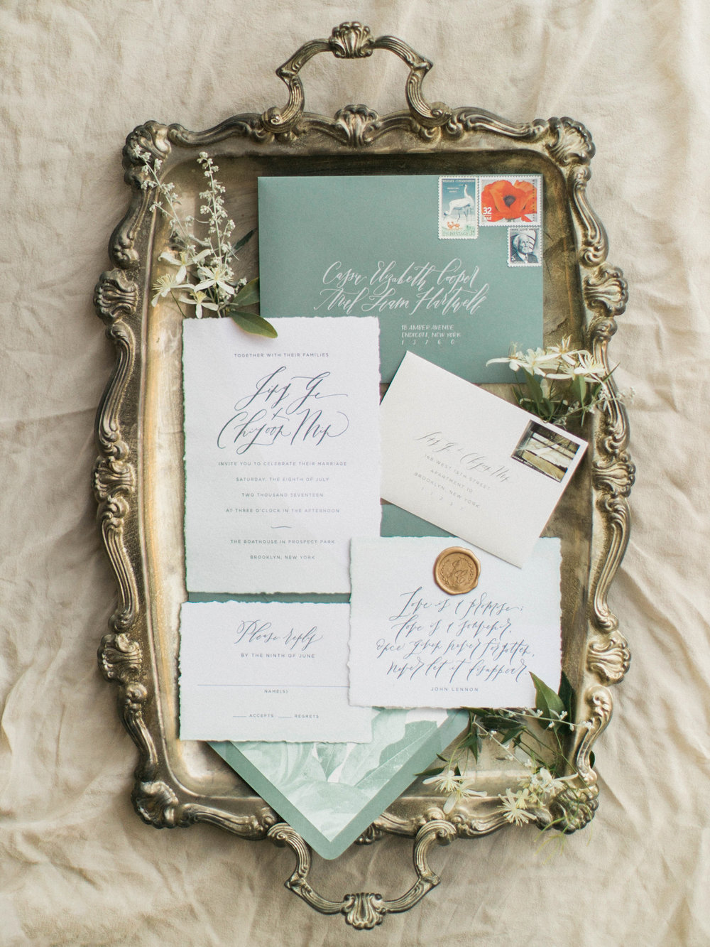 Deckled edge invitations and hand calligraphy addressing.  Invitations created by Regas Studio and Photo by Sophie Kaye Photography.