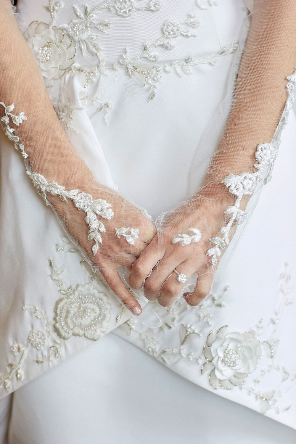 Detail on bride's custom gloves
