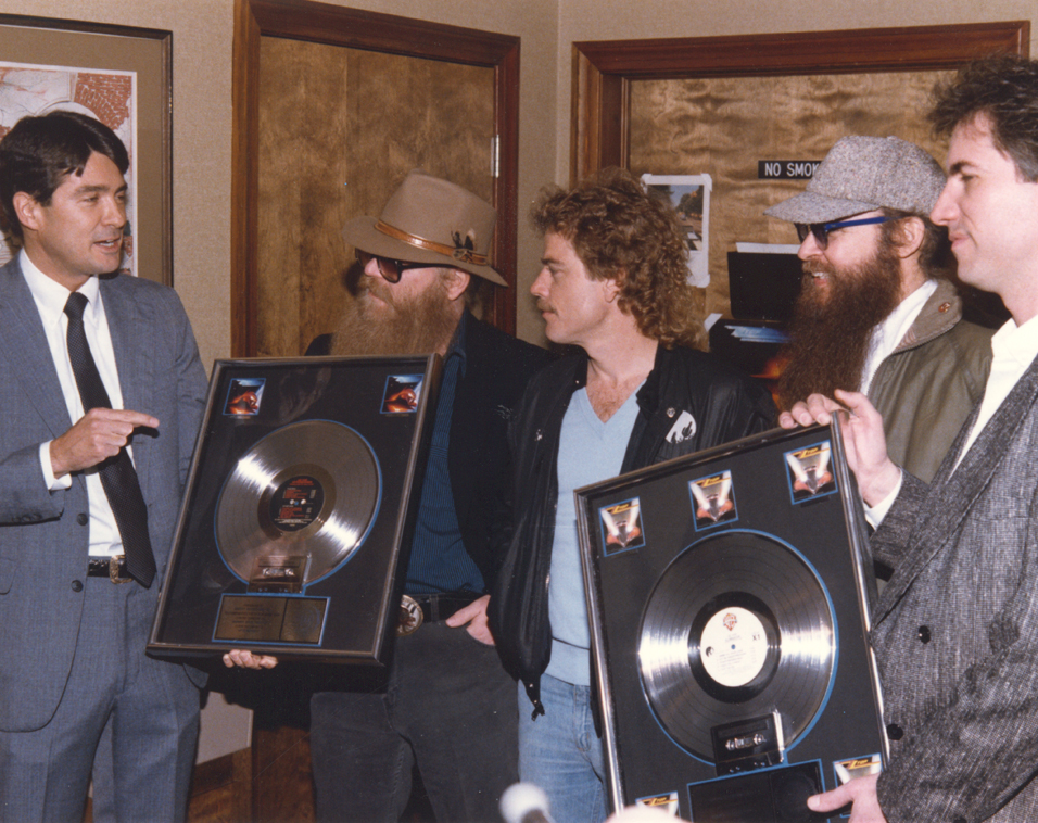 John Fry presenting ZZ Top their platinum records for Eliminator with Joe Hardy