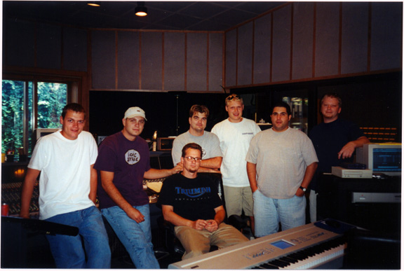 3 Doors Down with Paul Ebersold (seated) and Matt Martone (2nd from right)