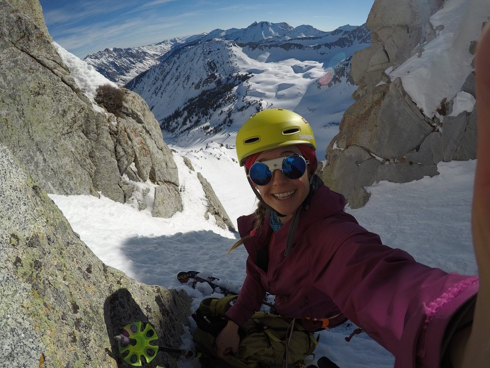 Stopping for a mandatory selfie atop one of the many ski descents. Caroline Gleich Photo