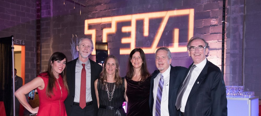 BenComm People in front of TEVA Sign 12.1.17.jpg