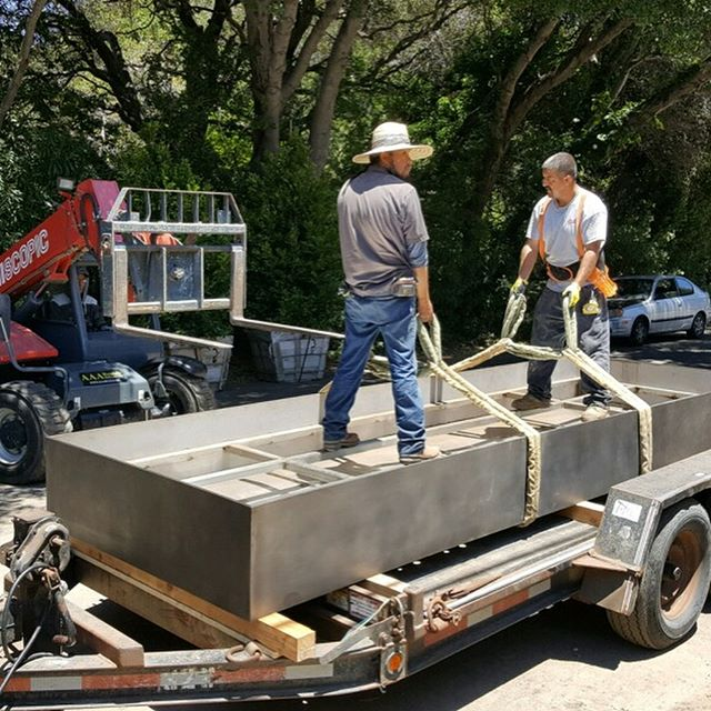 "Some action shots of a 16' long #fountain basin made from 1/2"" #stainless #steel plate being delivered and unloaded on site in #paloalto"