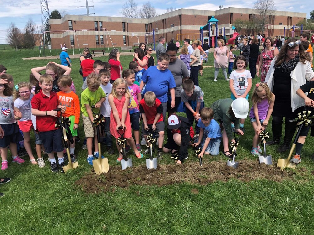 The students, representing all grades at the elementary level, along with current and past school board presidents who were key to promoting the new construction broke ground on the new building.