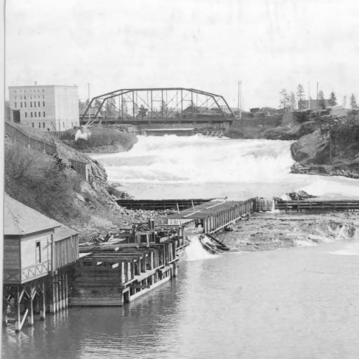 Industry, including power plants, flour mills and lumber mills dominated the Spokane River waterfront at the turn of the 20th century.  Courtesy of Northwest Room. Spokane Public Library