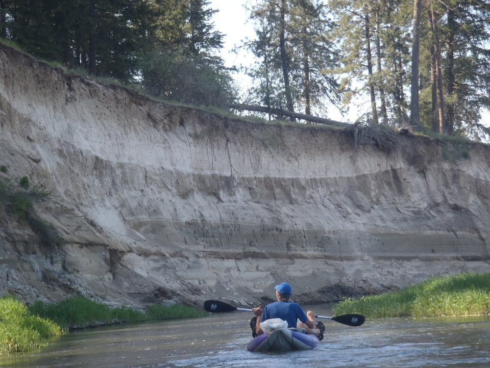 Dramatic cliffs of sediment show the erosion in Hangman Creek.