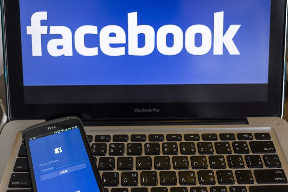 facebook-application-sign-in-page-on-smartphone-and-facebook-logo-on-background-facebook-is-largest-and-most-popular-social-networking-site-in-the-world_rveey0ldnMg.jpg