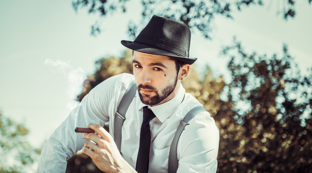 stock-photo-the-cigar-man-203864165.jpg