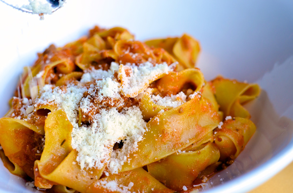 Pappardelle Bolognese with a bountiful amount of parmesan cheese.