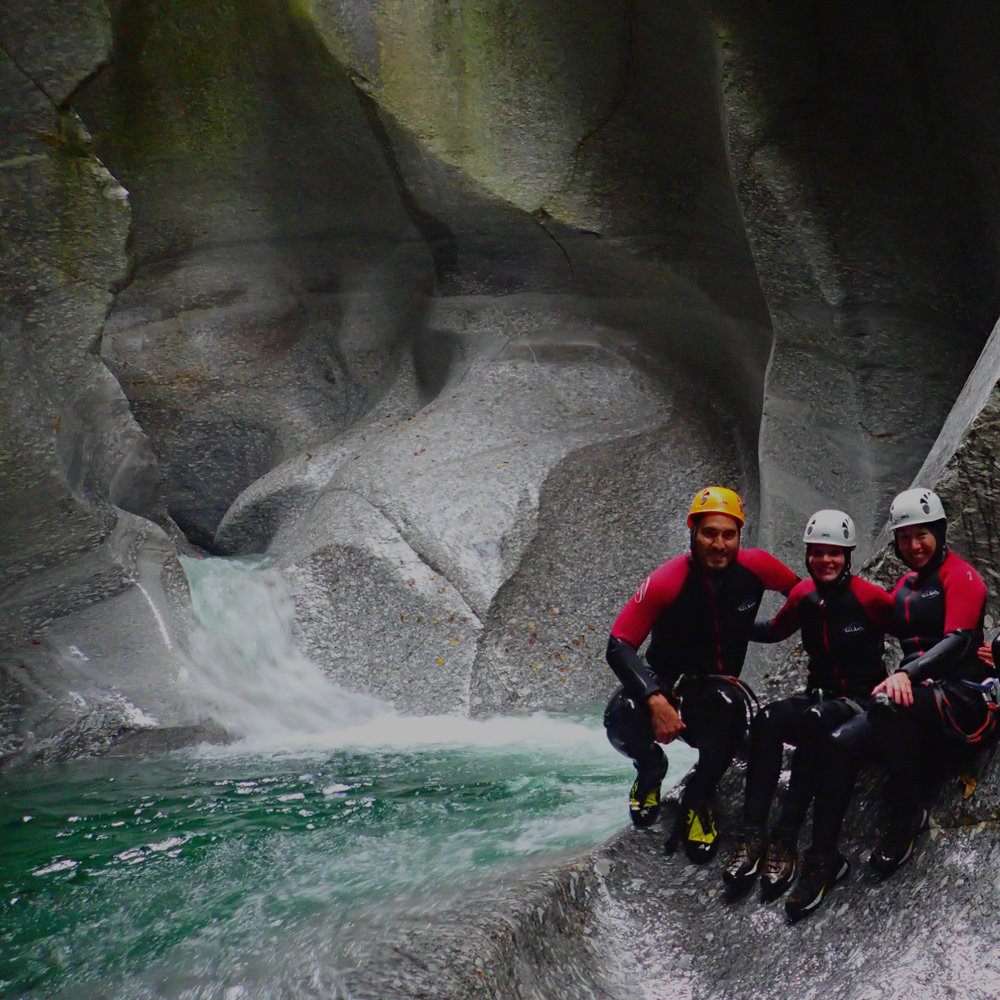 Canyoning in Switzerland - Hiking, swimming, jumping, sliding, and rappelling through natural and wild canyons in the Swiss Alps