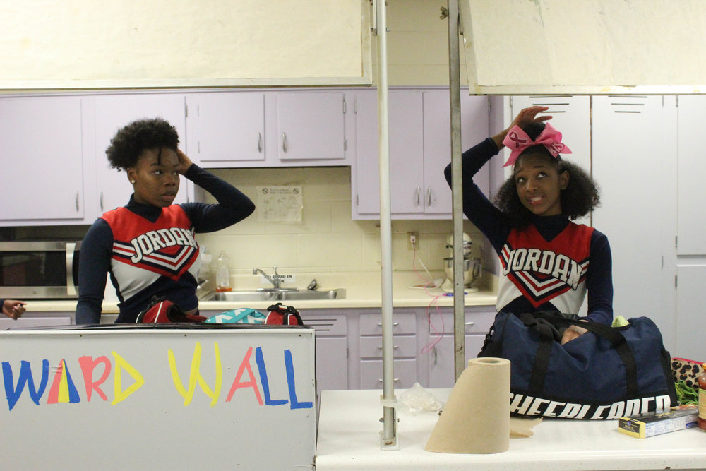Jaetta James (left) and Braxtyne Seetram (right) perfect their hair and makeup before a game. Not all the girls wear makeup to perform, but the ones who do treat it as a sacred pre-game ritual.    Many athletes are superstitious about their pre-game routines.