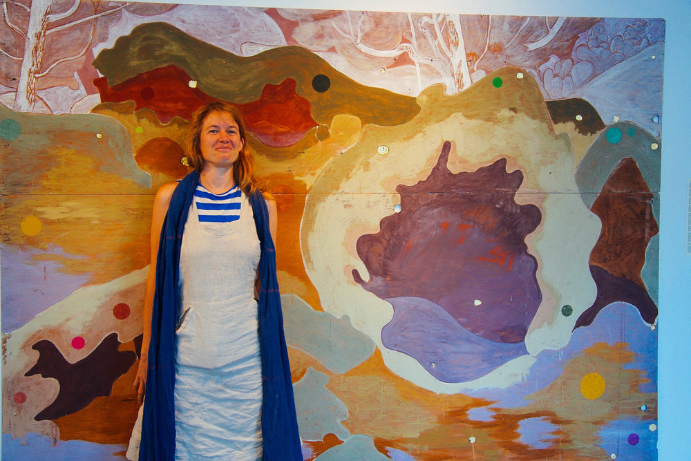 Tilke and her full sized initial Animal Village painting, as mentioned in our conversation on the Ground Shots Podcast.