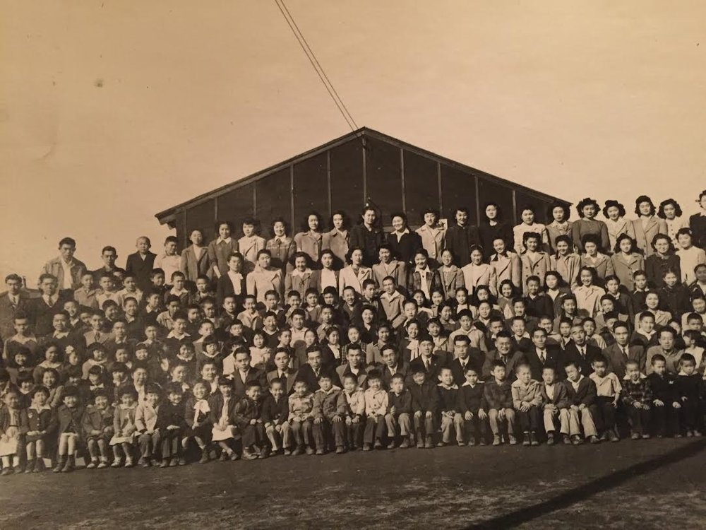 Actual photo of Manzanar camp facility.  Midori Sugimoto - Top Center, black coat.