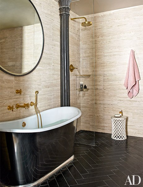 Travertine walls and black limestone flooring. What more could you ask for in a Master Bath?