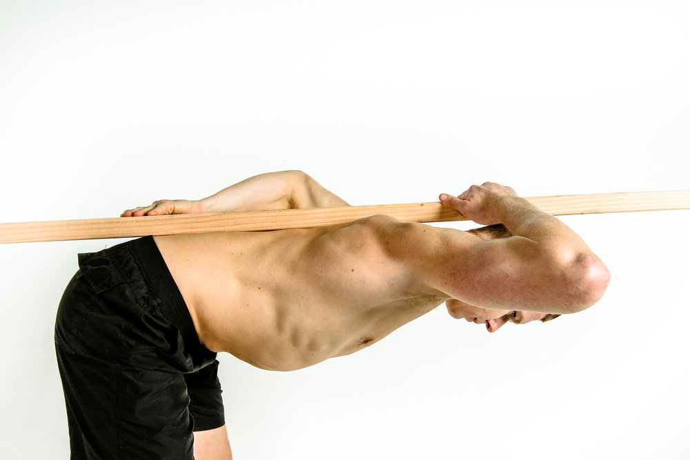 Proper hip hinge: Thoracic and lumbar spine remain in a neutral position as the person bends forward